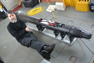 Mick West poses with Icefin, the robotic underwater vehicle built by GTRI and Georgia Tech. The team, known as Team SIMPLE (Sub-Ice Marine and PLanetary-analog Ecosytems), assembled Icefin on Antarctica.