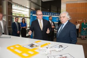 Michael Britt, left, Vice President of Southern Company's Energy Innovation Center, demonstrates new technology being developed to U.S. Secretary of Energy Ernest Moniz.