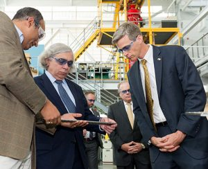 During a tour of the Carbon Neutral Energy Solutions Laboratory, U.S. Secretary of Energy Ernest Moniz receives a demonstration of a new design for a compact heat exchanger for supercritical carbon dioxide power cycle funded by the Department of Energy's Nuclear Energy University Program. Developer of the technology, Devesh Ranjan, associate professor of fluid mechanics in the School of Mechanical Engineering, explains the heat exchanger as Tim Lieuwen, Executive Director of the Strategic Energy Institute at Georgia Tech, looks on.